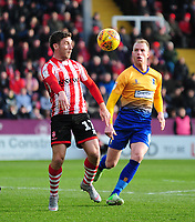 Lincoln City's Shay McCartan shields the ball from Mansfield Town's Neal Bishop<br /> <br /> Photographer Andrew Vaughan/CameraSport<br /> <br /> The EFL Sky Bet League Two - Lincoln City v Mansfield Town - Saturday 24th November 2018 - Sincil Bank - Lincoln<br /> <br /> World Copyright &copy; 2018 CameraSport. All rights reserved. 43 Linden Ave. Countesthorpe. Leicester. England. LE8 5PG - Tel: +44 (0) 116 277 4147 - admin@camerasport.com - www.camerasport.com