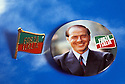 Pins with flag of Forza Italia and portrait of Silvio Berlusconi made for the electoral compaign of the new party, Polical elections will take place in Italy on the next 27, 28 March 1994. © Carlo Cerchioli