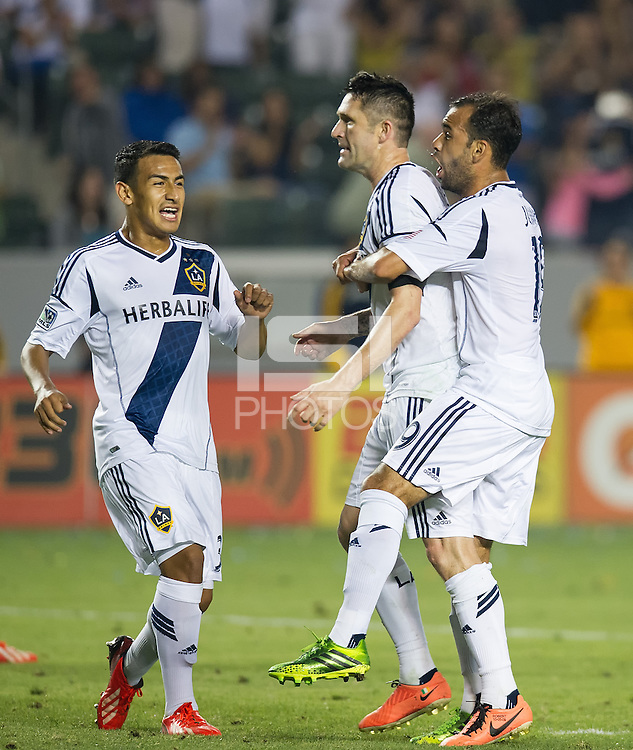 CARSON, CA - July 4, 2013: LA Galaxy players Jose Villarreal (33), Robbie Keane (7), Juninho (19) celebrate Keane's second goal during the LA Galaxy vs Columbus Crew match at the StubHub Center in Carson, California. Final score, LA Galaxy 2, Columbus Crew 1.
