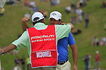 Graeme McDowell hugs his caddy after shooting a 63 to win with 15 under during the Final Day of The Celtic Manor Wales Open, 6th June 2010 (Photo by Eoin Clarke/GOLFFILE).