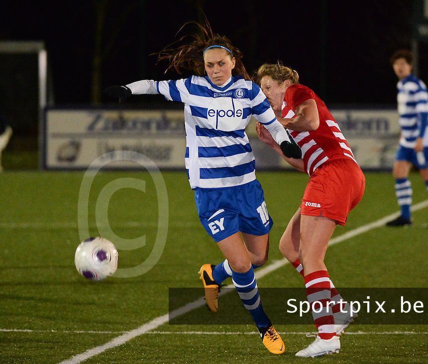 20140221 - OOSTAKKER , BELGIUM : Gent Jassina Blom (l) pictured with Antwerp Sophie Mannaert (r) during the soccer match between the women teams of AA Gent Ladies  and RAFC Antwerp Ladies , on the 19th matchday of the BeNeleague competition Friday 21 February 2014 in Oostakker. PHOTO DAVID CATRY
