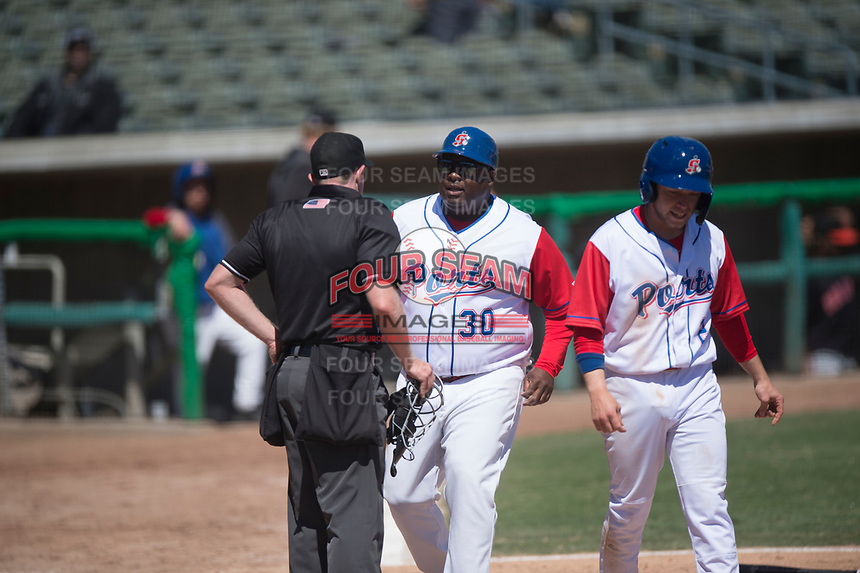 Stockton Ports manager Webster Garrison (30) argues a call with home plate umpire Chris Presley-Murphy during a California League game against the San Jose Giants on April 9, 2019 in Stockton, California. San Jose defeated Stockton 4-3. (Zachary Lucy/Four Seam Images)