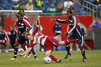 FC Dallas midfielder Bobby Rhine (19) and New England Revolution midfielder Sainey Nyassi (31). The New England Revolution defeated FC Dallas 2-1 during a Major League Soccer match at Gillette Stadium in Foxborough, MA, on June 6, 2008.