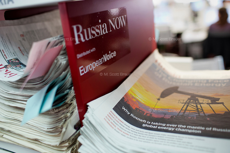 Issues of Russia Beyond the Headlines publications in different foreign languages stand in piles in RBTH's offices in Moscow, Russia. Russia Beyond the Headlines produces newspaper-like inserts as advertising in leading newspapers around the world, filled with Russia-focused news from a Russian perspective. The paper is produced by Rossiskaya Gazeta, one of Russia's state-owned newspapers.