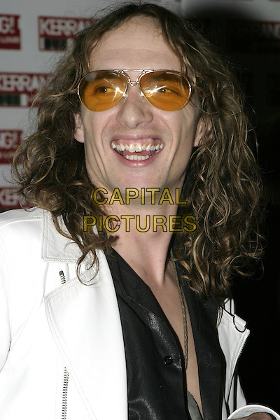 JUSTIN HAWKINS  THE DARKNESS).Kerrang Awards 2004, The Brewery, East London, .August 26th 2004..portrait headshot sunglasses.Ref: AH.www.capitalpictures.com.sales@capitalpictures.com.©Capital Pictures.
