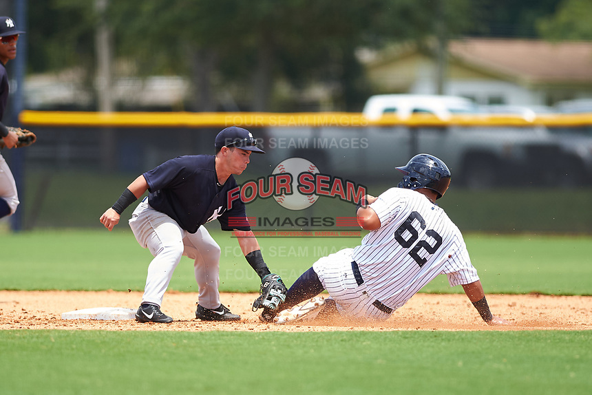 GCL Yankees West second baseman Jose Carrera (2) tags out a runner during the second game of a doubleheader against the GCL Yankees West on July 19, 2017 at the Yankees Minor League Complex in Tampa, Florida.  GCL Yankees West defeated the GCL Yankees East 3-1.  (Mike Janes/Four Seam Images)
