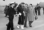 """HQ. FEAF, TOKYO --- Sgt. Juanito Magno of Iloilo City, P.I., receives a warm greeting from his countrymen as he arrives at a U.S. Air Force installation near Tokyo, after being flown from Korea as one of the first 36 repatriated UN sick and wounded men. Flanking the repatriate are the Cmdr. Santiago Nuval (left), chief of Phillippine Liaison Section, UN Command; Col. Ramon Aguirre (second from right) commanding officer of the Phillipines' 19th Battalion Combat Team, and Tomas DeCastro, first secretary of Phillippine Mission in Tokyo, representing the Phillippine minister. A U.S. Air Force c-124 """"Globemaster"""" of the 374th Troop Carrier Wing flew the initial 36 from Korea to Japan. April 1953."""
