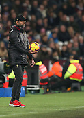 4th February 2019, London Stadium, London, England; EPL Premier League football, West Ham United versus Liverpool; Liverpool Manager Jurgen Klopp holding the match ball for a throw in on the touchline