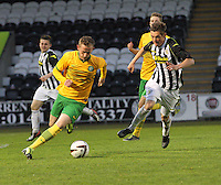 John Herron being pursued by Thomas Reilly in the St Mirren v Celtic Scottish Professional Football League Under 20 match played at St Mirren Park, Paisley on 30.4.14.