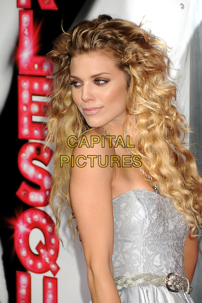 "ANNALYNNE McCORD .""Burlesque"" Los Angeles Premiere held at Grauman's Chinese Theatre, Hollywood, California, USA, .15th November 2010..half length strapless dress belt curly hair side  silver grey gray .CAP/ADM/BP.©Byron Purvis/AdMedia/Capital Pictures."