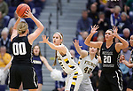SIOUX FALLS, SD: MARCH 12:  Paige Redmond #00 of Central Missouri looks to pass to teammate Megan Skaggs #20 as Presley O'Farrell #35 of Augustana defends during the 2018 NCAA Division II Women's Basketball Central Region Championship at the Elmen Center in Sioux Falls, S.D.  (Photo by Dick Carlson/Inertia)