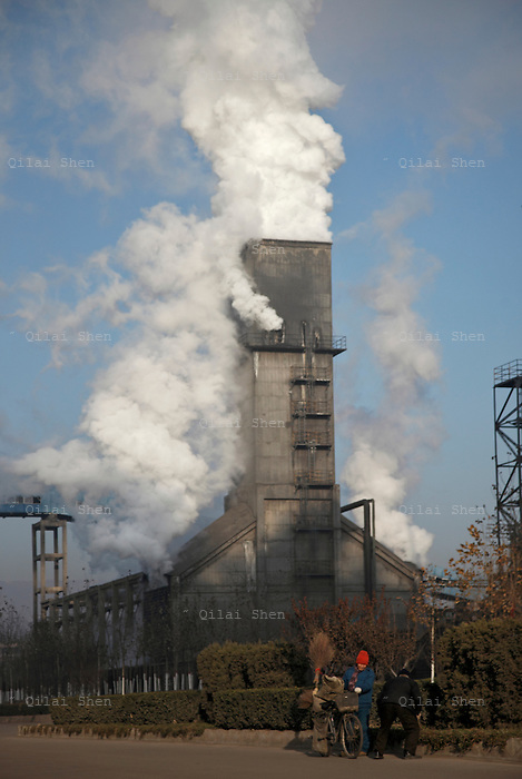 A coking factory discharges a plume of exhaust in Linfen, Shanxi Province, China on Thursday, 03 December, 2009.  Due to the heavy presence of coal mines and related industries, Linfen was named the world's most polluted city from 2004-2007.
