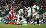 Emilio Izaguirre brings down Rory McKenzie for a penalty kick