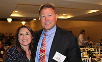 NWA Democrat-Gazette/CARIN SCHOPPMEYER Crystal Vickmark, CASA executive director, and Judge Tom Smith stand for a photo at the Celebration of Success.