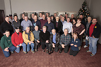 "January 8, 2013    2013 Iditarod Air Force pilots and their ""Support Personnel"" gather for a group photo at the Millenium Hotel during one of their monthly meetings."