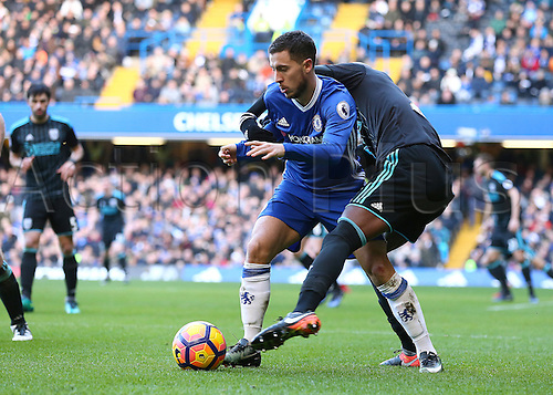 11.12.2016. Stamford Bridge, London, England. Premier League Football. Chelsea versus West Bromwich Albion. Chelsea Midfielder Eden Hazard is challenged by West Brom Defender Allan-Romeo Nyom, during a Chelsea attack