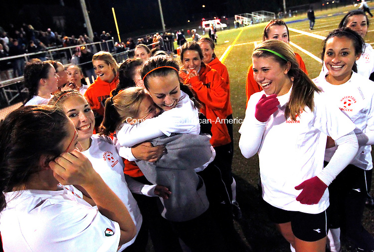 Waterbury, CT- 03, November 2010-110310CM02  The Watertown girls soccer team celebrate after defeating Naugatuck for the NVL title Wednesday night at Municipal Stadium in Waterbury.  They defeated the Greyhounds, 2-1. Christopher Massa Republican-American