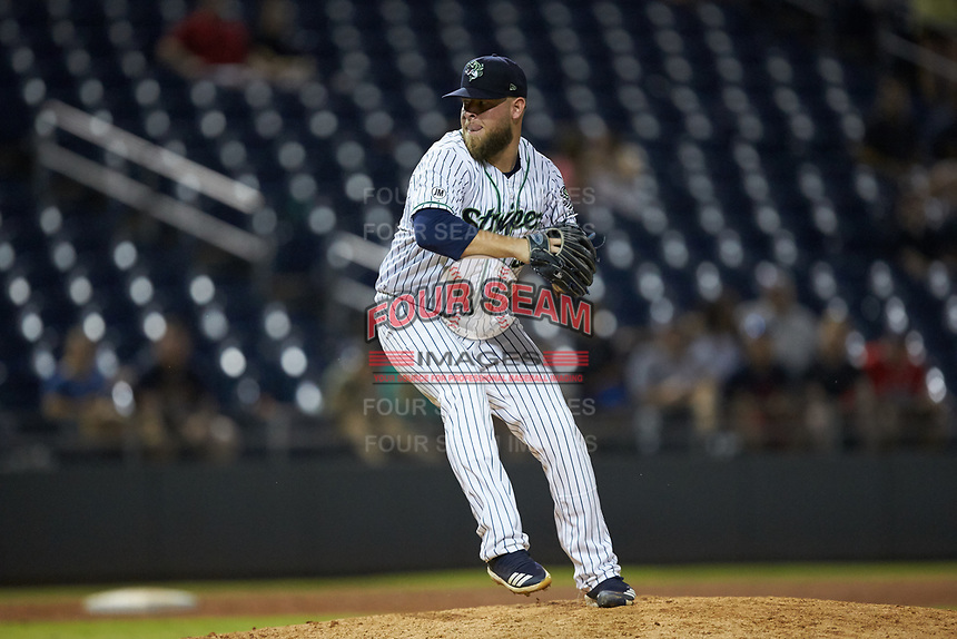Gwinnett Braves relief pitcher A.J. Minter (33) in action against the Scranton/Wilkes-Barre RailRiders at BB&T BallPark on August 17, 2019 in Lawrenceville, Georgia. The Stripers defeated the RailRiders 8-7 in eleven innings. (Brian Westerholt/Four Seam Images)