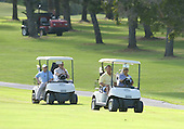 United States President Barack Obama drives a golf cart with passenger Bobby Titcomb as they and friends Marvin Nicholson and Eric Whitaker enjoy a round of golf at Mid Pacific Country Club, Kailua, Hawaii on Monday, December 23, 2013.  The first family is enjoying holiday vacation in Hawaii until January 5, 2014. <br /> Credit: Cory Lum / Pool via CNP