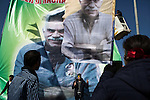 A man poses in front of a giant portrait of jailed PKK (Kurdistan Workers' Party) founder Abdullah Öcalan at the Newroz, the Kurdish New Year celebration, in Suruç, Turkey, March 17, 2015. Newroz, or Nowruz, is an ancient holiday celebrated by a multitude of ethnic groups across Iran, Central Asia, and the Caucuses, and ushers in the first day of Spring, March 21. For Kurds, Newroz is a means of political and cultural expression, featuring Kurdish politicians, activists, and musicians, and has become a manifestation of Kurdish identity. In Turkey, the celebrations begin a few days before the Vernal Equinox, culminating in a huge gathering in the heart of Turkey's Kurdish population, the southeastern city of Diyarbakir. This year, Öcalan, who despite serving a life sentence for treason still enjoys widespread influence among Kurds, sent a letter that was read at Newroz in Diyarbakir, calling for an end to the PKK's armed struggle against the Turkish state.