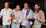 From left: Chefs Ryan Prewitt, Michael Hudman, Chris Shepherd and Andy Ticer holding bottles of Rose before a dinner at Underbelly Sunday August 09, 2015.(Dave Rossman photo)
