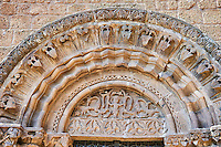 The left portal with geometric Norman-Sicilain elements in the archivolts and relief sculpture of mythical creatures in the lunette, Basilica Church of Santa Maria Maggiore, Tuscania