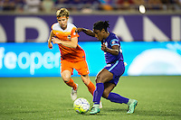 Orlando, Florida - Saturday, April 23, 2016: Orlando Pride forward Jasmyne Spencer (23) beats Houston Dash defender Rebecca Moros (4) and plays a pass out wide during an NWSL match between Orlando Pride and Houston Dash at the Orlando Citrus Bowl.