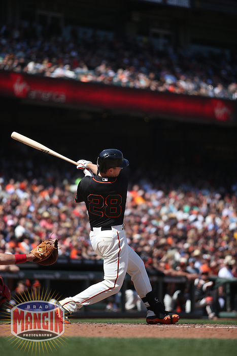 SAN FRANCISCO, CA - MAY 2:  Buster Posey #28 of the San Francisco Giants hits a home run against the Los Angeles Angels during the game at AT&T Park on Saturday, May 2, 2015 in San Francisco, California. Photo by Brad Mangin