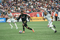 FOXBOROUGH, MA - AUGUST 4: Adama Diomande #99 of Los Angeles FC advances the ball with Andrew Farrell #2 of New England Revolution in pursuit during a game between Los Angeles FC and New England Revolution at Gillette Stadium on August 3, 2019 in Foxborough, Massachusetts.