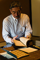 "Tokubee Masuda, CEO of the Tsukinokatsura sake brewery. He is looking at a historic document describing the brewing of koshu matured sake. Fushimi, Kyoto, Japan, October 10, 2015. Tsukinokatsura Sake Brewery was founded in 1675 and has been run by 14 generations of the Masuda family. Based in the famous sake brewing region of Fushimi, Kyoto, it has a claim to be the first sake brewery ever to produce ""nigori"" cloudy sake. It also brews and sells the oldest ""koshu"" matured sake in Japan."