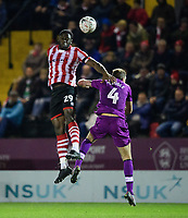 Lincoln City's John Akinde vies for possession with Carlisle United's Gary Liddle<br /> <br /> Photographer Chris Vaughan/CameraSport<br /> <br /> The Emirates FA Cup Second Round - Lincoln City v Carlisle United - Saturday 1st December 2018 - Sincil Bank - Lincoln<br />  <br /> World Copyright © 2018 CameraSport. All rights reserved. 43 Linden Ave. Countesthorpe. Leicester. England. LE8 5PG - Tel: +44 (0) 116 277 4147 - admin@camerasport.com - www.camerasport.com