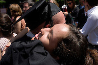Nick Culbertson, of Dunhellen, New Jersey, hugs his sister Ashley Lyles (center) after receiving his diploma at the Quincy House ceremony during Harvard University Commencement on May 26, 2011, in Cambridge, Massachusetts, USA.<br /> <br /> Photo: Photo: M. Scott Brauer for the Star-Ledger