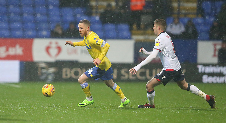 Leeds United's Adam Forshaw and Bolton Wanderers' Josh Vela<br /> <br /> Photographer Stephen White/CameraSport<br /> <br /> The EFL Sky Bet Championship - Bolton Wanderers v Leeds United - Saturday 15th December 2018 - University of Bolton Stadium - Bolton<br /> <br /> World Copyright © 2018 CameraSport. All rights reserved. 43 Linden Ave. Countesthorpe. Leicester. England. LE8 5PG - Tel: +44 (0) 116 277 4147 - admin@camerasport.com - www.camerasport.com