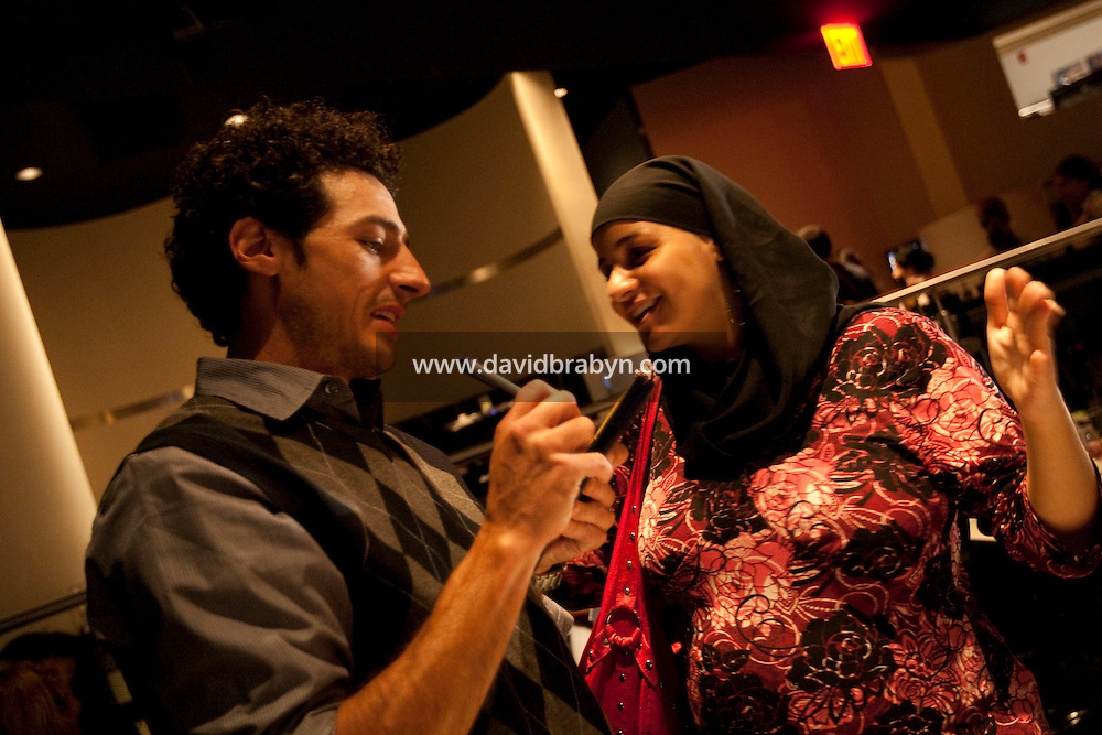 Comedian Aron Kader (L) signs an autograph for an audience member after performing in the 6th Annual NY Arab-American Comedy Festival in New York, USA, 13 May 2009.