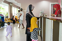 January 10, 2015 - Rawang (Malaysia). Patients wait for a pediatric consultancy in a private clinic owned by Global Ikhwan. The enterprise, which employs 4,000 people worldwide through its complicated network of subsidiaries, operates restaurants, clothing shops, noodle factories and health clinics - just to name a few. It also runs its own schools, care homes and rehabilitation centres. © Thomas Cristofoletti / Ruom