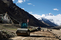 "China started building a controversial 67-mile ""paved highway fenced with undulating guardrails"" to Mount Qomolangma, known in the west as Mount Everest, to help facilitate next year's Olympic Games torch relay./// A steamroller sits outside Rongbuk Monastery  on the road to Everest Base Camp.<br /> Tibet, China<br /> July, 2007"