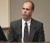 John Hair, an United States Federal Bureau of Investigation (FBI) cybercrime expert testifies during the penalty phase of the trial of convicted sniper John Allen Muhammad in courtroom 10 at the Virginia Beach Circuit Court in Virginia Beach, Virginia on November 18, 2003.  Hair identified several maps on the computer that was in the possession of Muhammad. John Muhammad was convicted of capital murder on November 17, 2003 for his role as organizer of a two-man sniper team that killed 10 people and terrorized the Washington, D.C., in 2002. <br /> Credit: Dave Ellis - Pool via CNP