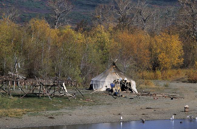 Even yurt & autumn tundra by a river near Tilishki..Kamchatka. Siberia. Russia