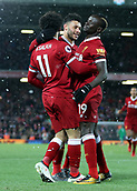 17th March 2018, Anfield, Liverpool, England; EPL Premier League football, Liverpool versus Watford; Mohammed Salah of Liverpool is congratulated by team mates Alex Oxlade-Chamberlain and Sadio Mane  after completing his hat trick