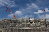 The new National Stadium rises high above the surrounding area as preparations for the 2020 Tokyo Olympics continue in Gaiemmae, Tokyo, Japan. Friday May 25th 2018
