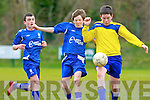 Jack Grffin Ballyhar and Michael Potts Killarney Athletic in action during their cup tie in Killarney on Saturday..
