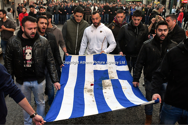 Pictured: A rally consisting mostly of young students holding the Greek flag of the Polytechnic, parades through the city on its way to the US Embassy to mark the 43rd anniversary of the Polytechnic Uprising in Athens Greece. Thursday 17 November 2016<br /> Re: 43rd anniversary of the Athens Polytechnic uprising of 1973 which was a massive demonstration of popular rejection of the Greek military junta of 1967–1974. The uprising began on November 14, 1973, escalated to an open anti-junta revolt and ended in bloodshed in the early morning of November 17 after a series of events starting with a tank crashing through the gates of the Polytechnic.