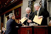 United States President George W. Bush, left,  hands copies of his speech to United States Vice President Dick Cheney, center, and the Speaker of the United States House of Representatives J. Dennis Hastert (Republican from the 14th District of Illinois), right, prior to delivering his State ofthe Union Address to a Joint Session of Congress in the Capitol in Washington, D.C. on February 2, 2005.  <br /> Credit: Luke Frazza / Pool via CNP