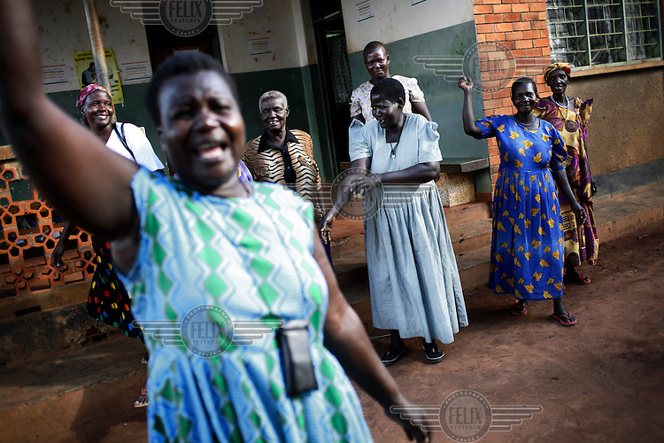 In a Northern Ugandan camp for internally displaced persons (IDP camp), nurses sing and dance to welcome visitors from an international NGO. .