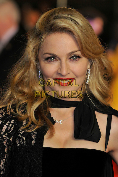 Madonna.W.E. Uk film premiere at Odeon cinema, Kensington, London, England..11th January 2011.headshot portrait black lace bow red lipstick   .CAP/PL.©Phil Loftus/Capital Pictures.