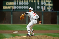 SAN FRANCISCO, CA - John Burkett of the San Francisco Giants pitches during a turn back the clock game against the Chicago Cubs at Candlestick Park in San Francisco, California in 1991. Photo by Brad Mangin