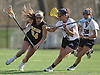 Nikki Sliwak #34 of Wantagh, left, gets pressured by Katie Hudson #21 of Cold Spring Harbor during a Nassau County varsity girls lacrosse game at Cold Spring Harbor High School on Thursday, Apr. 21, 2016. Sliwak scored the game-winning goal with 12.8 seconds remaining to propel Wantagh to an 11-10 victory.