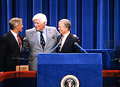 Speaker of the United States House of Representatives Tip O'Neill (Democrat of Massachusetts), center, and US Vice President Walter Mondale, left, and US President Jimmy Carter, right, on the podium of the 1980 Democratic National Convention in Madison Square Garden in New York, New York on August 13, 1980.<br /> Credit: Arnie Sachs / CNP