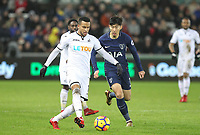 Martin Olsson of Swansea City  & Son Heung-Min of Spurs during the Premier League match between Swansea City and Tottenham Hotspur at the Liberty Stadium, Swansea, Wales on 2 January 2018. Photo by Mark Hawkins / PRiME Media Images.