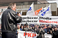 Henri Masse, ex president of the Quebec Federation of Labour (FTQ) speaks to the crowd during a protest for the one-year mark of the lockout at the Quebecor owned Journal de Quebec newspaper in Quebec city April 20, 2007.